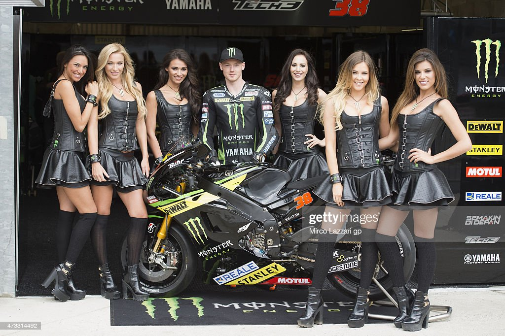 <a gi-track='captionPersonalityLinkClicked' href=/galleries/search?phrase=Bradley+Smith+-+Motorcyclist&family=editorial&specificpeople=5349000 ng-click='$event.stopPropagation()'>Bradley Smith</a> of Great Britain and Monster Yamaha Tech 3 poses with the grid girl in pit before the MotoGp of France - Press Conference on May 14, 2015 in Paris, France.