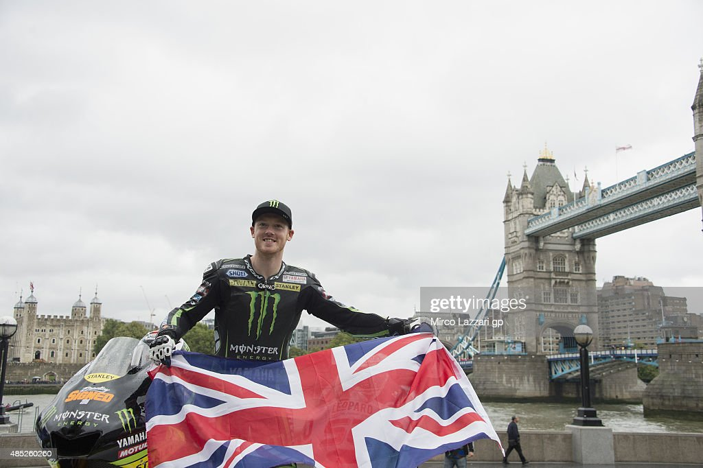 <a gi-track='captionPersonalityLinkClicked' href=/galleries/search?phrase=Bradley+Smith+-+Motorcyclist&family=editorial&specificpeople=5349000 ng-click='$event.stopPropagation()'>Bradley Smith</a> of Great Britain and Monster Yamaha Tech 3 smiles with the flag during the pre-event 'MotoGP stars gear-up for Octo British GP with London visit' during the MotoGp Of Great Britain - Previews in London on August 26, 2015 in London, United Kingdom.