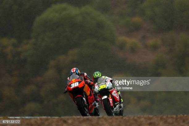 Bradley Smith of Great Britain and Red Bull KTM Factory Racing rides ahead of Cal Crutchlow of Great Britain and LCR Honda during free practice for...