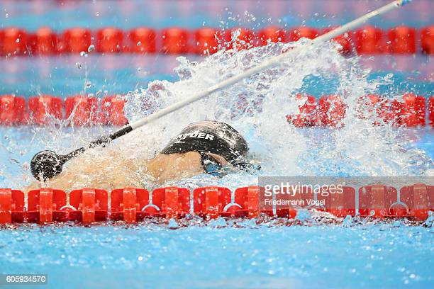 Bradley Snyder of the United States is tapped before finishing to win the gold medal at the Men's 100m Freestyle S11 Final during day 8 of the Rio...