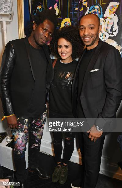 Bradley Theodore Nathalie Emmanuel and Thierry Henry attend a VIP private view for New York artist Bradley Theodore at Maddox Gallery on April 19...