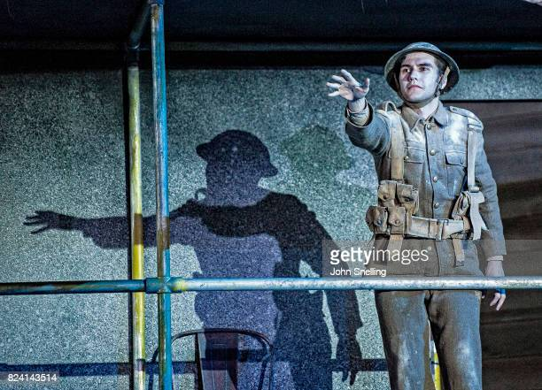 Bradley Travis as Siegfried Sassoon with the Company perform on stage during a performance of 'Silver Birch' a new opera by Roxanna at Garsington...