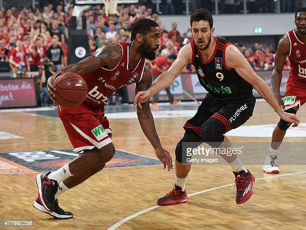 Bradley Wanamaker of Brose Baskets Bamberg dribbles against Vasilije Micic of FC Bayern Muenchen during Game Five of the 2015 BBL Finals at Brose...
