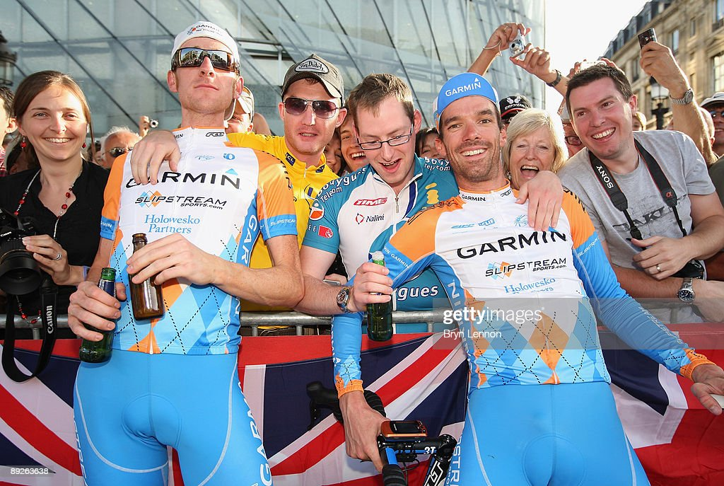 Bradley Wiggins (L) and David Millar of Great Britain and Team Garmin pose with fans after Stage Twenty One of the Tour de France on July 26, 2009 in Paris, France.