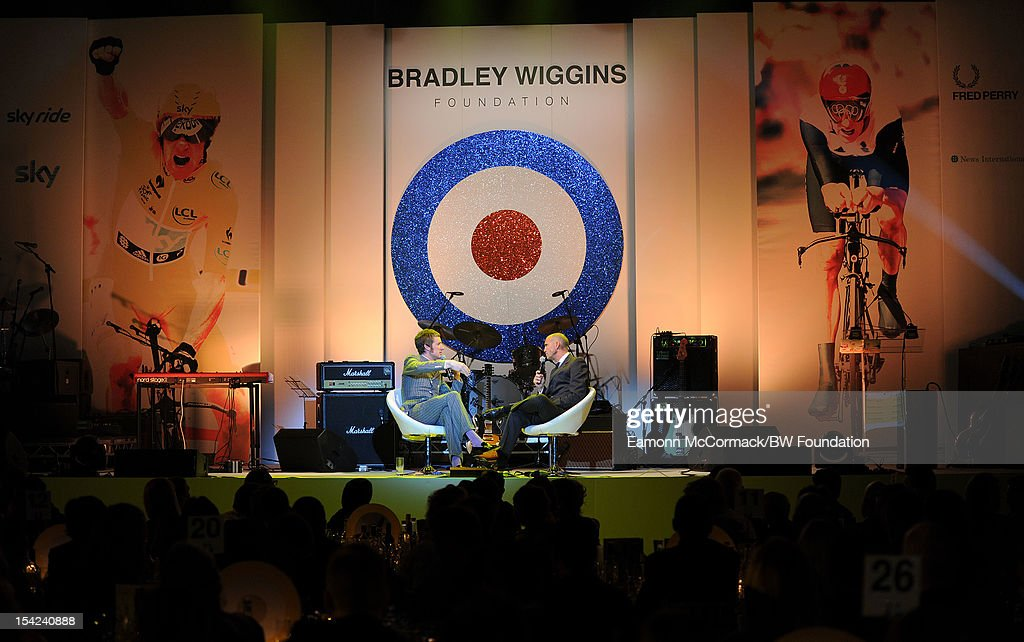 <a gi-track='captionPersonalityLinkClicked' href=/galleries/search?phrase=Bradley+Wiggins&family=editorial&specificpeople=182490 ng-click='$event.stopPropagation()'>Bradley Wiggins</a> and <a gi-track='captionPersonalityLinkClicked' href=/galleries/search?phrase=Johnny+Vaughan&family=editorial&specificpeople=208208 ng-click='$event.stopPropagation()'>Johnny Vaughan</a> as they attends the <a gi-track='captionPersonalityLinkClicked' href=/galleries/search?phrase=Bradley+Wiggins&family=editorial&specificpeople=182490 ng-click='$event.stopPropagation()'>Bradley Wiggins</a> Foundation 'The Yellow Ball' event at The Roundhouse on October 16, 2012 in London, England. The dinner and entertainment show was held to celebrate the historic achievements of Great Britain's cyclist <a gi-track='captionPersonalityLinkClicked' href=/galleries/search?phrase=Bradley+Wiggins&family=editorial&specificpeople=182490 ng-click='$event.stopPropagation()'>Bradley Wiggins</a> in 2012, including his Tour de France win and Olympic gold achievements. The Foundation aims to promote participation in sport, to encourage young people to exercise regularly, and to support athletes from all sports to take their talent to the next level.