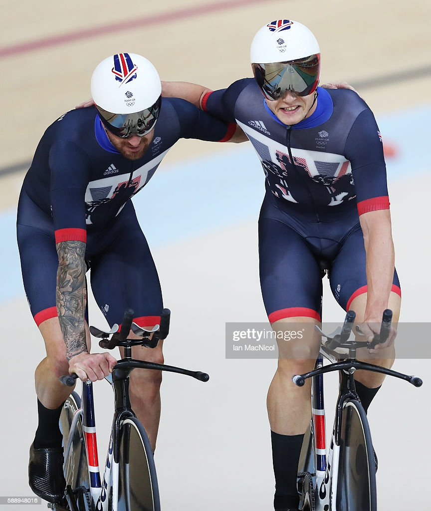 Bradley Wiggins and Steven Burke of Team Great Britain celebrate Gold in the Men's Team Pursuit Final on Day 7 of the Rio 2016 Olympic Games at Rio Olympic Velodrome on August 12, 2016 in Rio de Janeiro, Brazil.