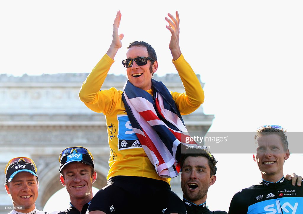 Bradley Wiggins of Great Britain and SKY Procycling (C) celebrates on a processional lap alongside teammates (L-R) Edvald Boasson Hagen, Michael Rogers, Bernhard Eisel and Christian Knees after winning the 2012 Tour de France after the twentieth and final stage of the 2012 Tour de France, from Rambouillet to the Champs-Elysees on July 22, 2012 in Paris, France.