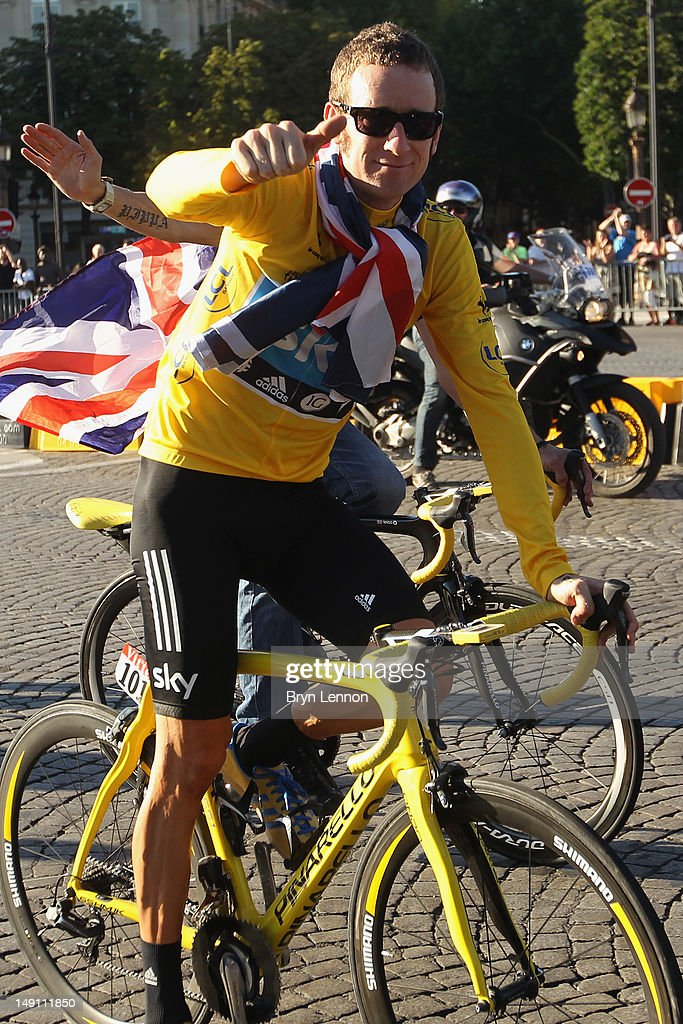 <a gi-track='captionPersonalityLinkClicked' href=/galleries/search?phrase=Bradley+Wiggins&family=editorial&specificpeople=182490 ng-click='$event.stopPropagation()'>Bradley Wiggins</a> of Great Britain and SKY Procycling celebrates on a processional lap after winning the 2012 Tour de France after the twentieth and final stage of the 2012 Tour de France, from Rambouillet to the Champs-Elysees on July 22, 2012 in Paris, France.