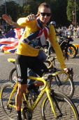 Bradley Wiggins of Great Britain and SKY Procycling celebrates on a processional lap after winning the 2012 Tour de France after the twentieth and...