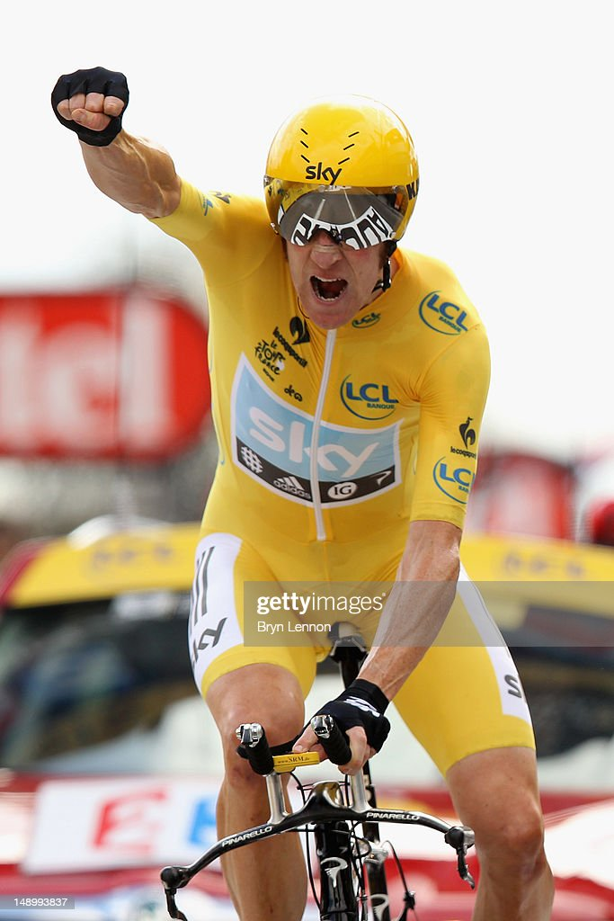 Bradley Wiggins of Great Britain and SKY Procycling punches the air with delight as he celebrates winning the stage and securing the yellow jersey of the general classification during stage nineteen of the 2012 Tour de France, a 53.5km time trial from Bonneval to Chartres on July 21, 2012 in Chartres, France.