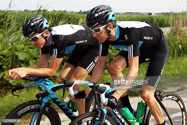 Bradley Wiggins of Great Britain and Team SKY chats to team mate Geraint Thomas during a training ride in preparation for the 2010 Tour de France on...
