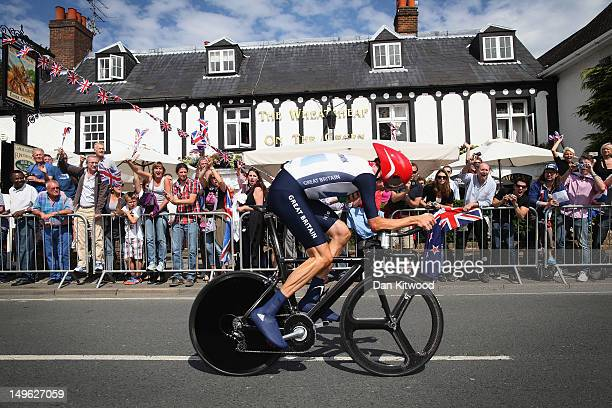 Bradley Wiggins of Great Britain cycles past a pub in Esher during the Men's Individual Time Trial Road Cycling on day 5 of the London 2012 Olympic...