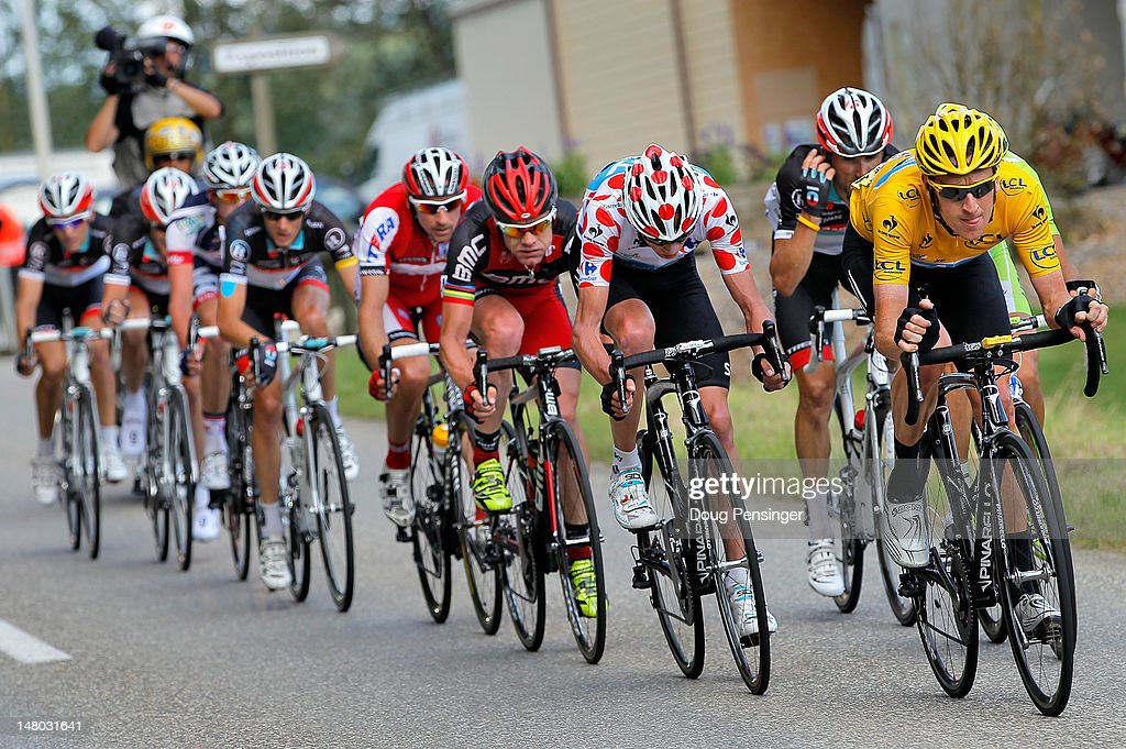 <a gi-track='captionPersonalityLinkClicked' href=/galleries/search?phrase=Bradley+Wiggins&family=editorial&specificpeople=182490 ng-click='$event.stopPropagation()'>Bradley Wiggins</a> of Great Britain riding for Sky Procycling does a turn on the front of the group in the final kilometers as he defended the race leader's yellow jersey during stage eight of the 2012 Tour de France from Belfort, France to Porrentruy, Switzerland on July 8, 2012 in Porrentruy, Switzerland.