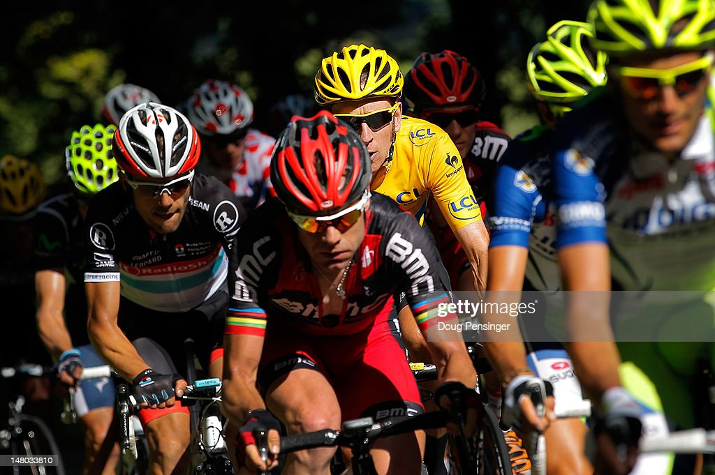 <a gi-track='captionPersonalityLinkClicked' href=/galleries/search?phrase=Bradley+Wiggins&family=editorial&specificpeople=182490 ng-click='$event.stopPropagation()'>Bradley Wiggins</a> of Great Britain riding for Sky Procycling follows the wheel of <a gi-track='captionPersonalityLinkClicked' href=/galleries/search?phrase=Cadel+Evans&family=editorial&specificpeople=661127 ng-click='$event.stopPropagation()'>Cadel Evans</a> of Australia riding for BMC Racing on the Col de la Croix during stage eight of the 2012 Tour de France from Belfort, France to Porrentruy, Switzerland on July 8, 2012 in Saint-Ursanne, Switzerland. Wiggins defended the race leader's yellow jersey during the stage.