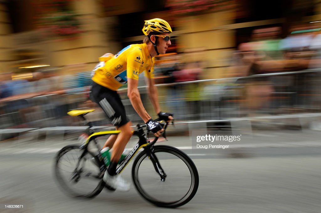 <a gi-track='captionPersonalityLinkClicked' href=/galleries/search?phrase=Bradley+Wiggins&family=editorial&specificpeople=182490 ng-click='$event.stopPropagation()'>Bradley Wiggins</a> of Great Britain riding for Sky Procycling in the race leader's yellow jersey makes his way to the start of stage twelve of the 2012 Tour de France from Saint-Jean de Maurienne to Annonay on July 13, 2012 in Saint-Jean de Maurienne, France.