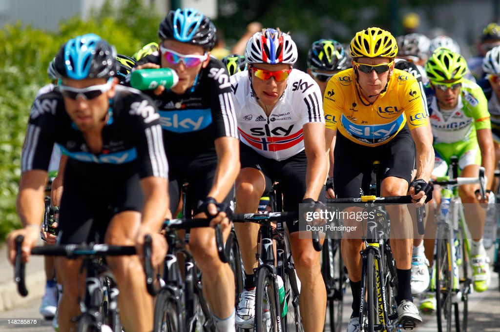 <a gi-track='captionPersonalityLinkClicked' href=/galleries/search?phrase=Bradley+Wiggins&family=editorial&specificpeople=182490 ng-click='$event.stopPropagation()'>Bradley Wiggins</a> (2nd R) of Great Britain riding for Sky Procycling is escorted by his team-mates (L-R) <a gi-track='captionPersonalityLinkClicked' href=/galleries/search?phrase=Bernhard+Eisel&family=editorial&specificpeople=695991 ng-click='$event.stopPropagation()'>Bernhard Eisel</a>, <a gi-track='captionPersonalityLinkClicked' href=/galleries/search?phrase=Christian+Knees&family=editorial&specificpeople=541153 ng-click='$event.stopPropagation()'>Christian Knees</a> and <a gi-track='captionPersonalityLinkClicked' href=/galleries/search?phrase=Edvald+Boasson+Hagen&family=editorial&specificpeople=4451245 ng-click='$event.stopPropagation()'>Edvald Boasson Hagen</a> as he defends the race leader's yellow jersey in stage twelve of the 2012 Tour de France from Saint-Jean de Maurienne to Annonay on July 13, 2012 in Annonay, France.