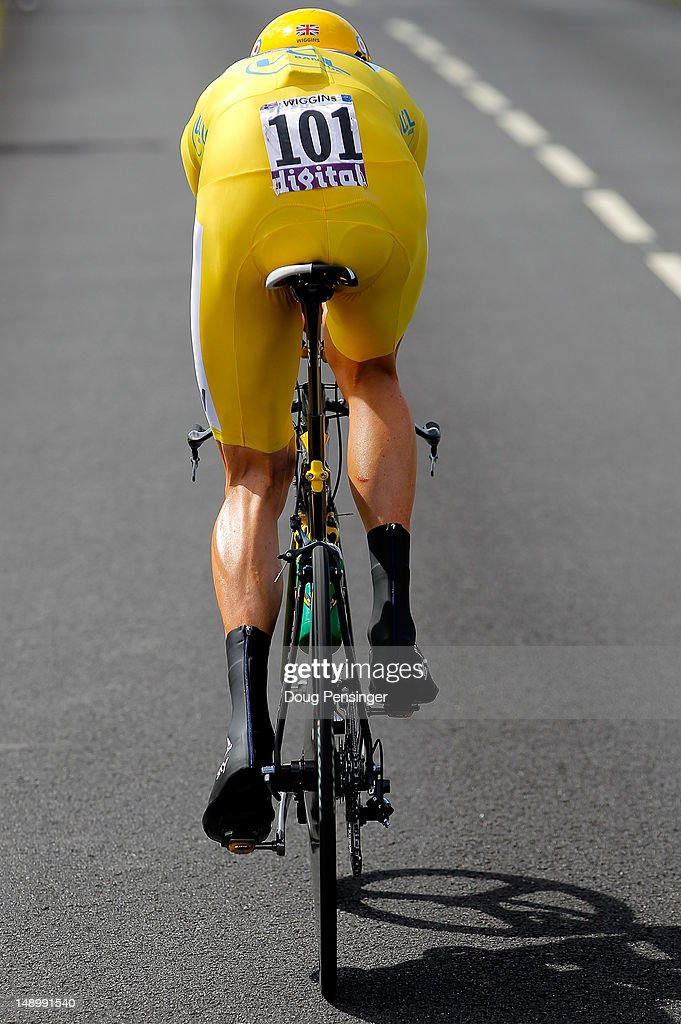 <a gi-track='captionPersonalityLinkClicked' href=/galleries/search?phrase=Bradley+Wiggins&family=editorial&specificpeople=182490 ng-click='$event.stopPropagation()'>Bradley Wiggins</a> of Great Britain riding for Sky Procycling races to first place in the individual time trial in stage nineteen and defends the race leader's yellow jersey in the 2012 Tour de France from Bonneval to Chartres on July 21, 2012 in Chartres, France.