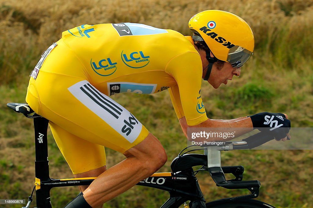 Bradley Wiggins of Great Britain riding for Sky Procycling races to first place in the individual time trial in stage nineteen and defends the race...