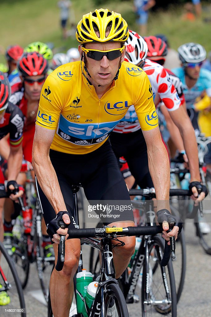 <a gi-track='captionPersonalityLinkClicked' href=/galleries/search?phrase=Bradley+Wiggins&family=editorial&specificpeople=182490 ng-click='$event.stopPropagation()'>Bradley Wiggins</a> of Great Britain riding for Sky Procycling rides in the peloton as he defended the race leader's yellow jersey during stage eight of the 2012 Tour de France from Belfort, France to Porrentruy, Switzerland on July 8, 2012 in Mouillet, Switzerland.