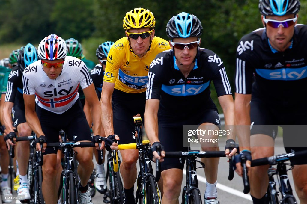 <a gi-track='captionPersonalityLinkClicked' href=/galleries/search?phrase=Bradley+Wiggins&family=editorial&specificpeople=182490 ng-click='$event.stopPropagation()'>Bradley Wiggins</a> (2L) of Great Britian riding for Sky Procycling in the race leader's yellow jersey climbs of the Col du Grand Columbier under escort of his teammates Edvald Boasson Hagan (L) of Norway, Michael Rogers (2R) of Australia and Berhard Eisel (R) of Austria during stage ten of the 2012 Tour de France from Macon to Bellegarde-Sur-Valserine on July 11, 2012 in La Sapette, France.