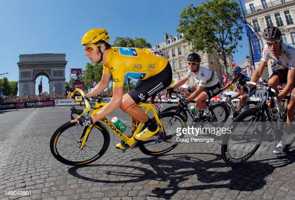 Bradley Wiggins of SKY Procycling rounds the arc d'triomphe during the twentieth and final stage of the 2012 Tour de France from Rambouillet to the...