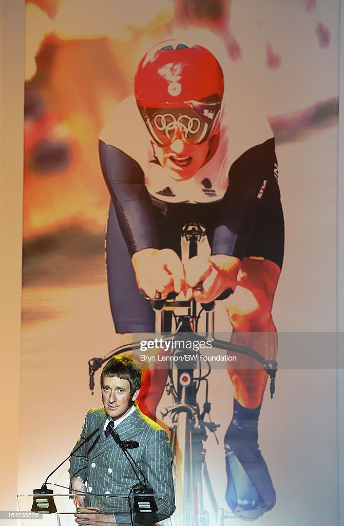 <a gi-track='captionPersonalityLinkClicked' href=/galleries/search?phrase=Bradley+Wiggins&family=editorial&specificpeople=182490 ng-click='$event.stopPropagation()'>Bradley Wiggins</a> speaks to guests at the <a gi-track='captionPersonalityLinkClicked' href=/galleries/search?phrase=Bradley+Wiggins&family=editorial&specificpeople=182490 ng-click='$event.stopPropagation()'>Bradley Wiggins</a> Foundation 'The Yellow Ball' event at The Roundhouse on October 16, 2012 in London, England. The dinner and entertainment show was held to celebrate the historic achievements of Great Britain's cyclist <a gi-track='captionPersonalityLinkClicked' href=/galleries/search?phrase=Bradley+Wiggins&family=editorial&specificpeople=182490 ng-click='$event.stopPropagation()'>Bradley Wiggins</a> in 2012, including his Tour de France win and Olympic gold achievements. The Foundation aims to promote participation in sport, to encourage young people to exercise regularly, and to support athletes from all sports to take their talent to the next level.