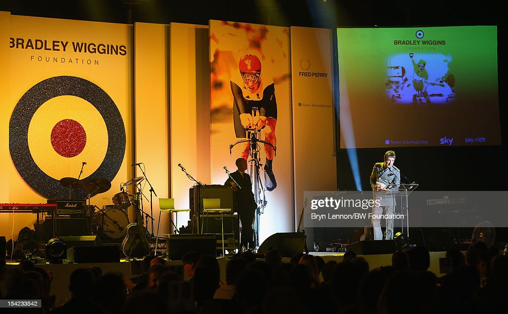 Bradley Wiggins speaks to guests at the Bradley Wiggins Foundation 'The Yellow Ball' event at The Roundhouse on October 16 2012 in London England The...