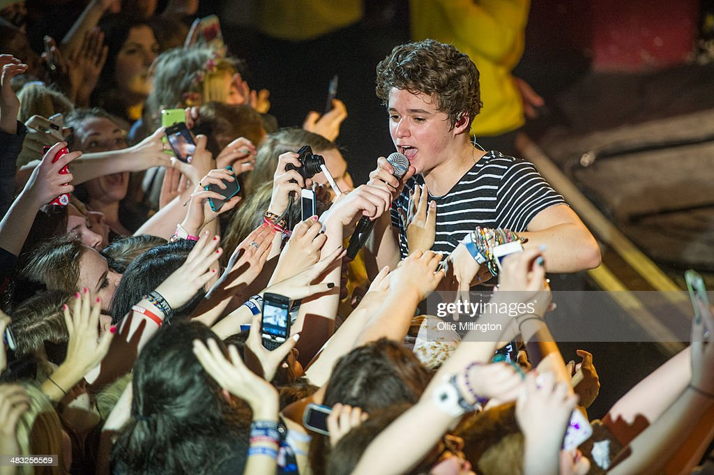 Bradley Will 'Brad' Simpson of The Vamps performs on stage during the 'The Last Night' single launch party, the band's first UK headline show, at at Shepherds Bush Empire on April 7, 2014 in London, United Kingdom.