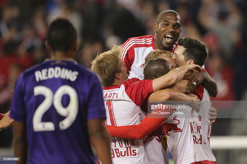 Bradley Wright-Phillips, (bottom), #99 of New York Red Bulls' is congratulated by teammates <a gi-track='captionPersonalityLinkClicked' href=/galleries/search?phrase=Ronald+Zubar&family=editorial&specificpeople=1295892 ng-click='$event.stopPropagation()'>Ronald Zubar</a>, #23 (top), Mike Grella, #13 and <a gi-track='captionPersonalityLinkClicked' href=/galleries/search?phrase=Sacha+Kljestan&family=editorial&specificpeople=577421 ng-click='$event.stopPropagation()'>Sacha Kljestan</a>, #16, after scoring his sides second goal during the New York Red Bulls Vs Orlando City MLS regular season match at Red Bull Arena, Harrison, New Jersey on April 24, 2016 in New York City.
