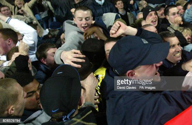 Bradley WrightPhillips and Micah Richards are swamped by City fans after Richards late equiliser against Aston Villa in the FA Cup 5th Round tie at...