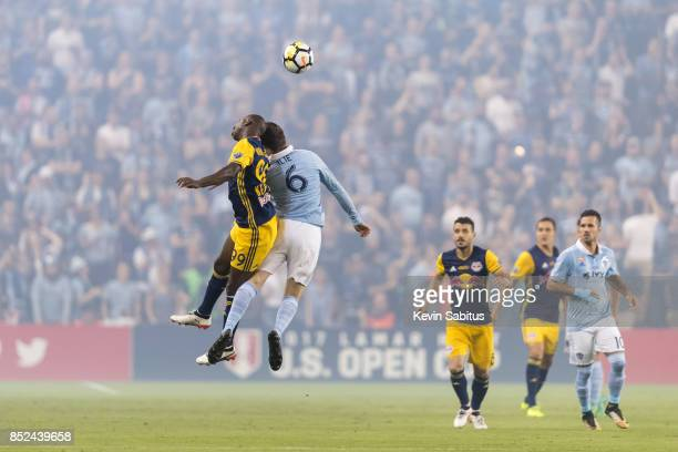 Bradley WrightPhillips of New York Red Bulls and Ilie Sanchez of Sporting Kansas City challenge for the ball in the US Open Cup Final match at...