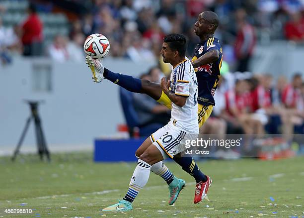 Bradley WrightPhillips of New York Red Bulls controls the ball while defended by AJ DeLaGarza of Los Angeles Galaxy in the first half at StubHub...