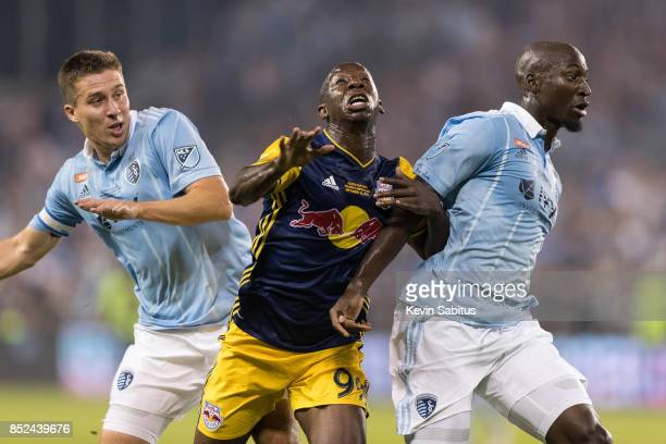 Bradley WrightPhillips of New York Red Bulls fights for the ball between Matt Besler and Ike Opara of Sporting Kansas City in the US Open Cup Final...