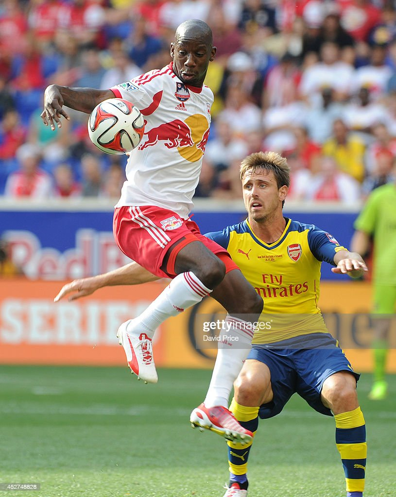 Bradley Wright-Phillips of New York Red Bulls under pressure from <a gi-track='captionPersonalityLinkClicked' href=/galleries/search?phrase=Nacho+Monreal&family=editorial&specificpeople=4078049 ng-click='$event.stopPropagation()'>Nacho Monreal</a> of Arsenal during the pre season match between New York Red Bulls and Arsenal at Red Bull Arena on July 26, 2014 in Harrison, New Jersey.