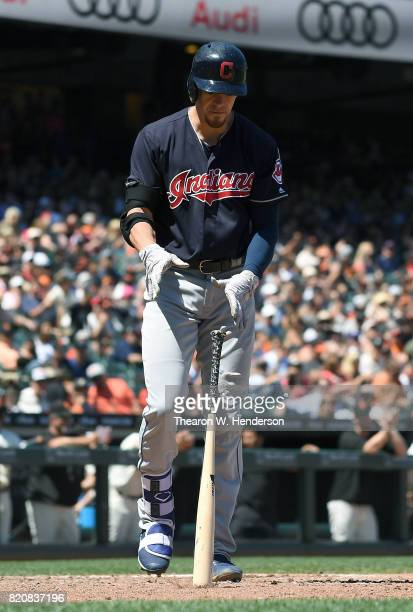 Bradley Zimmer of the Cleveland Indians slams his bat to the ground after striking out swinging against the San Francisco Giants in the top of the...