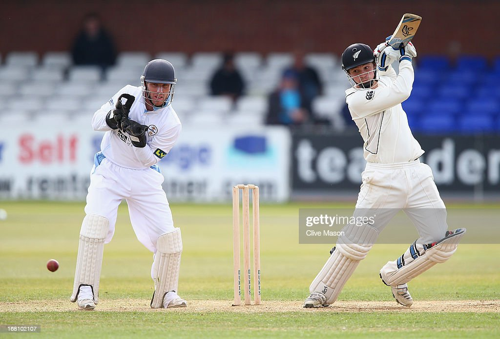 BradleyJohn Watling of New Zealand in action batting as Richard Johnson of Derbyshire looks on on day two of the tour match between Derbyshire and...