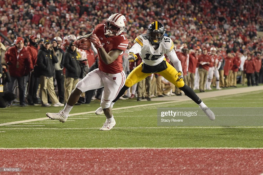 Bradrick Shaw #7 of the Wisconsin Badgers avoids a tackle by Joshua Jackson #15 of the Iowa Hawkeyes during the fourth quarter of a game at Camp Randall Stadium on November 11, 2017 in Madison, Wisconsin.