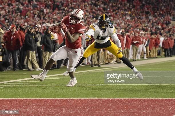 Bradrick Shaw of the Wisconsin Badgers avoids a tackle by Joshua Jackson of the Iowa Hawkeyes during the fourth quarter of a game at Camp Randall...