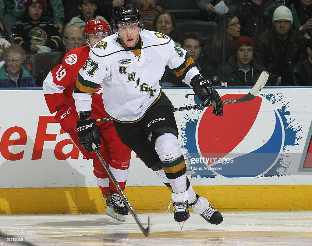 Brady Austin #57 of the London Knights skates against the Sault Ste. Marie Greyhounds during an OHL game at the Budweiser Gardens on December 4, 2013 in London, Ontario, Canada. The Knights defeated the Greyhounds 3-2.
