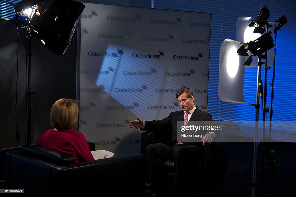 Brady Dougan, chief executive officer of Credit Suisse Group AG, right, gestures during a Bloomberg Television interview in Zurich, Switzerland, on Wednesday, April 24, 2013. Credit Suisse Group AG, the second- biggest Swiss bank, posted a jump in first-quarter profit as year-earlier charges related to its own debt and bonus payments weren't repeated. Photographer: Gianluca Colla/Bloomberg via Getty Images