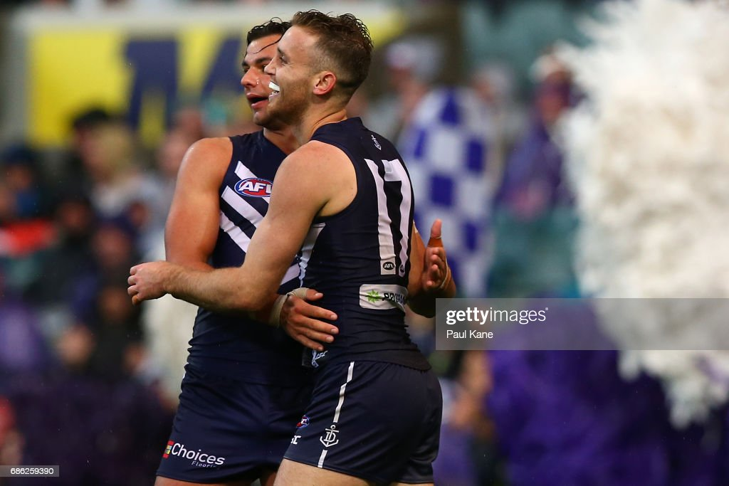 Brady Grey and Hayden Crozier of the Dockers celebrate a goal during the round nine AFL match between the Fremantle Dockers and the Carlton Blues at Domain Stadium on May 21, 2017 in Perth, Australia.