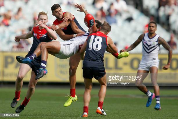Brady Grey of the Dockers attempts to mark the ball as Christian Salem of the Demons spoils during the round four AFL match between the Melbourne...