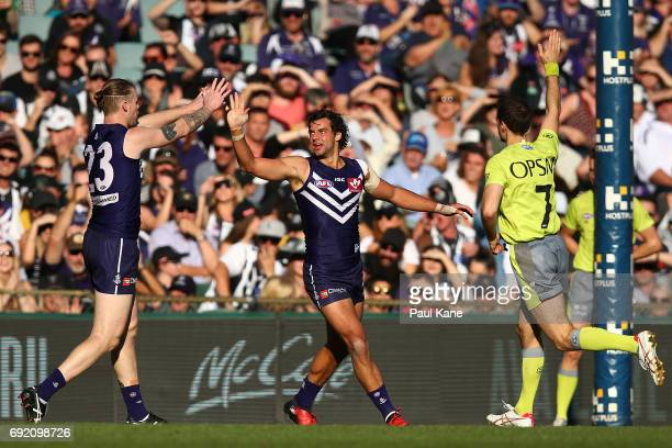 Brady Grey of the Dockers celebrates a goal with Cam McCarthy during the round 11 AFL match between the Fremantle Dockers and the Collingwood Magpies...