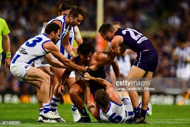 Brady Grey of the Dockers is pulled off Lachlan Hansen of the Kangaroos during the 2017 AFL round 05 match between the Fremantle Dockers and the...