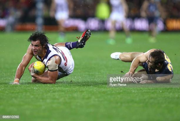 Brady Grey of the Dockers is tackled by Richard Douglas of the Crows during the round 10 AFL match between the Adelaide Crows and the Fremantle...