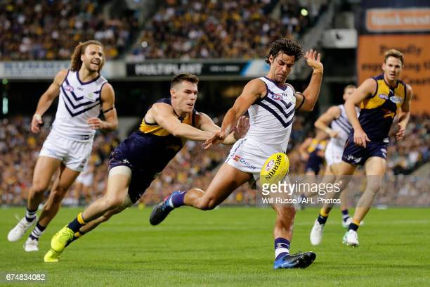 Brady Grey of the Dockers kicks the ball during the round six AFL match between the West Coast Eagles and the Fremantle Dockers at Domain Stadium on...