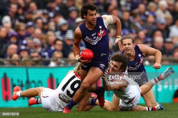 Brady Grey of the Dockers looks to pass the ball during the round 15 AFL match between the Fremantle Dockers and the St Kilda Saints at Domain...