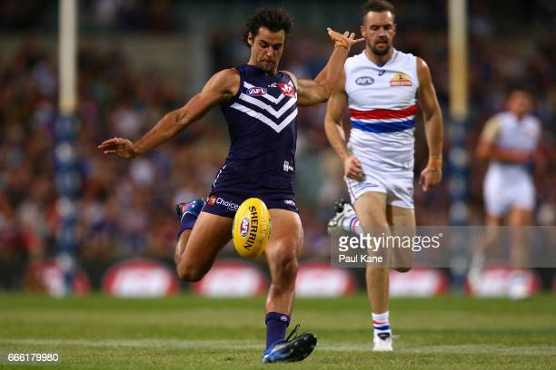Brady Grey of the Dockers passes the ball during the round three AFL match between the Fremantle Dockers and the Western Bulldogs at Domain Stadium...