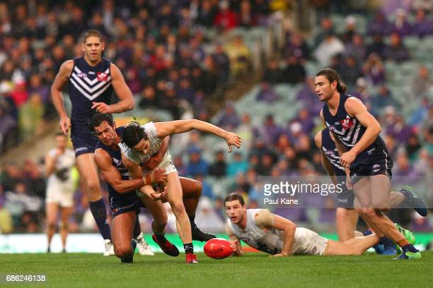 Brady Grey of the Dockers tackles Zac Fisher of the Blues during the round nine AFL match between the Fremantle Dockers and the Carlton Blues at...