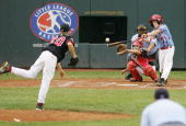 Brady Hamilton of the Southeast team from Georgia drives in his teams fourth run in the fifth inning with a base hit against Jace Fry of the...